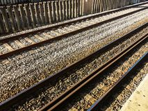 Angles. In railroad with sunlight incident on the trails royalty free stock photos