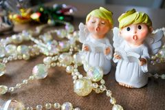 The angles sing, with thread of crystal beads. Lovely and twinkle in Christmas season greeting Stock Images