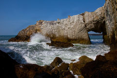 The Anglesey coastline. The white arch near Rhoscolyn Coastline Isle of Anglesey North Wales Stock Photography