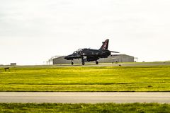 Anglesey , Wales - April 26 2018 : British Aerospace Hawk T.2 landing at Anglesey RAF valley airport.  stock photos