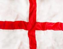 Anglia flaga państowowa z falowanie tkaniną zdjęcia stock
