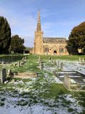 Church and graveyard in winter landscape with snow, UK royalty free stock images