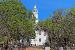 The Anglican parish church of Saint Helena in Beaufort, South Ca. Main building, spire and part of the graveyard at the parish church of St. Helena. The current Stock Photography
