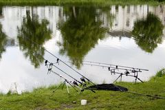Angling-rods near pond Stock Photography