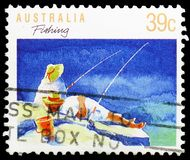 Angling, Sports serie, circa 1989. MOSCOW, RUSSIA - MARCH 23, 2019: A stamp printed in Australia shows Angling, Sports serie, circa 1989 royalty free stock photos