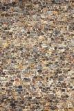 Anglonormański średniowieczny kamiennej ściany tło Zdjęcia Royalty Free
