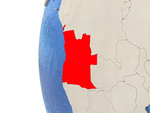 Angola on 3D globe. Map of Angola on globe with watery blue oceans and landmass with visible country borders. 3D illustration Royalty Free Stock Photography