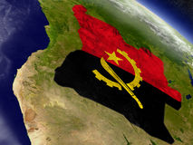 Angola with embedded flag on Earth Stock Photo