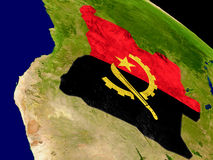 Angola with flag on Earth Stock Images