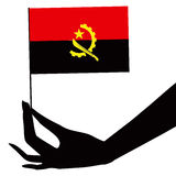 Angola flag in his hand Royalty Free Stock Photos