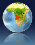 Angola on globe with reflection. Illustration with detailed planet surface. Elements of this image furnished by NASA Royalty Free Stock Photos