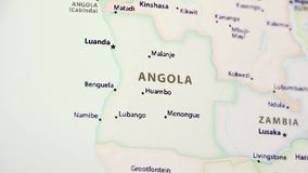 Angola on a Map. Angola on a political map of the world. Video defocuses showing and hiding the map stock video footage