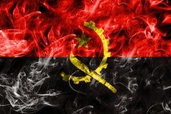 Angola rökflagga som isoleras på en svart bakgrund Arkivfoton
