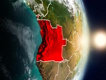 Angola during sunrise. Highlighted in red on planet Earth with visible country borders. 3D illustration. Elements of this image furnished by NASA Stock Photo