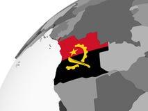 Angola z flaga na kuli ziemskiej Fotografia Royalty Free