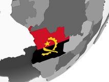 Angola z flaga na kuli ziemskiej Zdjęcia Stock
