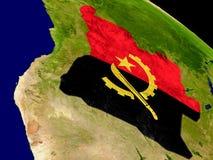 Angola z flaga na ziemi Zdjęcia Stock