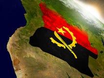 Angola z flaga w powstającym słońcu Obraz Royalty Free