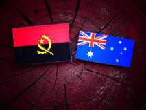 Angolan flag with Australian flag on a tree stump. Angolan flag with Australian flag on a tree stump Stock Images