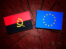 Angolan flag with EU flag on a tree stump isolated. Angolan flag with EU flag on a tree stump Stock Images