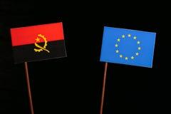 Angolan flag with European Union EU flag isolated on black. Background Royalty Free Stock Images