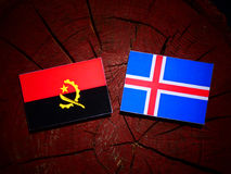 Angolan flag with Icelandic flag on a tree stump isolated Royalty Free Stock Photos