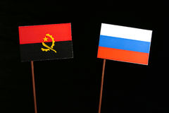 Angolan flag with Russian flag isolated on black Stock Photos