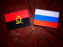 Angolan flag with Russian flag on a tree stump. Angolan flag with Russian flag on a tree stump Stock Photography