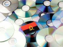 Angolan flag on top of CD and DVD pile  on white Stock Photography