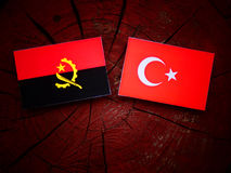 Angolan flag with Turkish flag on a tree stump. Angolan flag with Turkish flag on a tree stump Royalty Free Stock Images
