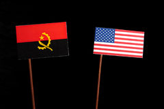 Angolan flag with USA flag isolated on black Stock Images