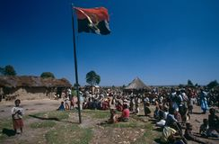 The Angolan national flag in a camp, Angola. Stock Photos