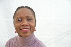 Angolan woman smiling. An image of a smiling African wearing red lipstick Stock Images