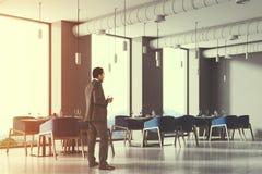 Angolo blu del caffè del sottotetto delle sedie, uomo d'affari Fotografia Stock