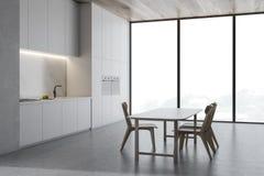Angolo concreto della cucina del sottotetto con la tavola di legno royalty illustrazione gratis