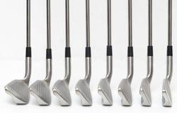 Angolo del club di golf su priorità bassa bianca. Fotografie Stock