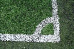 Angolo dell'erba del campo di calcio Immagini Stock