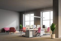 Angolo di ufficio open space, sofà e poltrone grigi illustrazione di stock