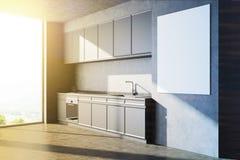 Angolo grigio della cucina con un lato del manifesto Immagini Stock