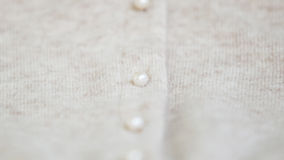 Angora wool cardigan with pearl button. Stock Photo