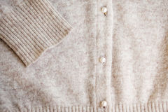 Angora wool cardigan with pearl button. stock image