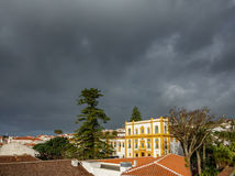 Angra do Heroismo roofs and stormy clouds in Azores islands