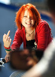 Angree Teen girl. With orange hair pulling finger Stock Photos