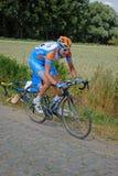 Angreifender Mitfahrer im Tour de France Stockfotos
