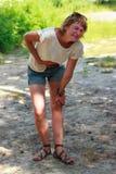 Angriff von Schmerz in den Frauen Stockfoto