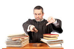Angry. Male judge in a courtroom striking the gavel and pronounces sentence. Focus at front y very shallow depth of field Royalty Free Stock Photos