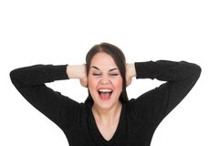 Angry. Terrible noise, obstruct her work, angry young woman Royalty Free Stock Image