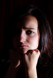 Angry. Photo of sad brunette girl in the dark Stock Photos