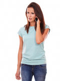 Angry adult brunette talking on her cell Stock Images