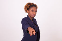 Angry African American business woman pointing finger to the scr Royalty Free Stock Photo